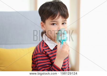 Boy using asthma machine at home