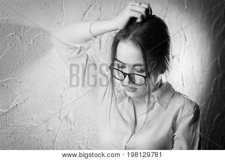 beautiful sad girl portrait near white wall, monochrome