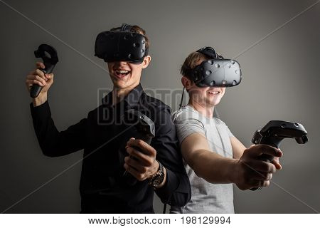 Two Young Man Playing Game Using Virtual Reality Headset