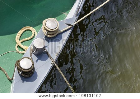 Bollards and ropes on a ship moored in harbor