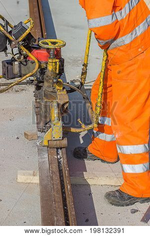 Tramway Track Construction Worker With Rail Grinding Machine