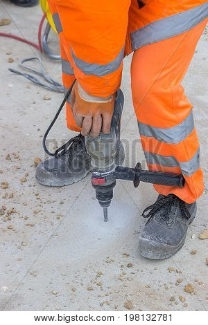 Worker Drilling Into Concrete