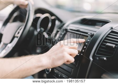 Man Using modern Gps Navigation System In Car to travel