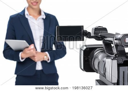 Cropped View Of Newscaster With Digital Tablet Standing In Front Of Camera, Isolated On White
