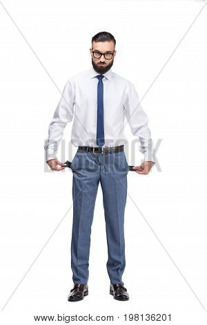Handsome Poor Businessman With Empty Pockets, Isolated On White