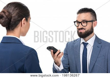 Male Journalist Taking Interview With Businesswoman, Isolated On White