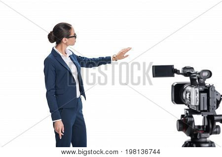 Beautiful Female Newscaster Presenting Something In Front Of Camera, Isolated On White