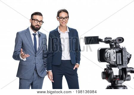 Selective Focus Of Two Newscasters Taking And Looking At Camera, Isolated On White