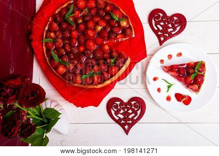 Strawberry Pie On White Plate And White Wooden Table. One Piece. Top View.  Romantic. Love. Heart.
