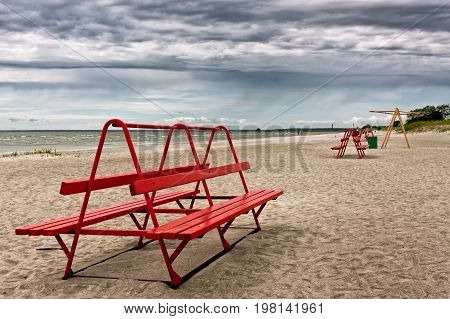 Red Bench On A Beach