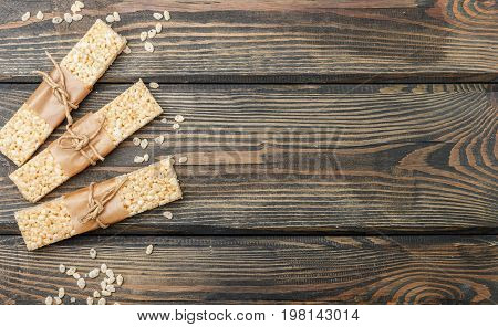 Crispy rice bars with honey and marshmallows on the wood surface. Healthy snack. Selective focus. Copy space