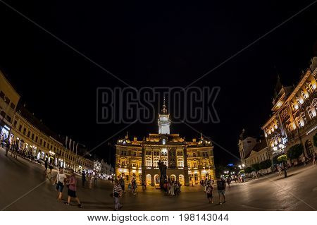 NOVI SAD SERBIA - JULY 30 2017: Night view of the Liberty Square (Trg. Slobode) with City Hall tourists and old buildings. One of the cities designated as the European capital of culture in 2021.