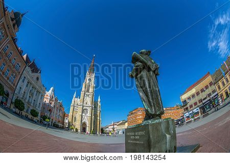 NOVI SAD SERBIA - JULY 30 2017: View of the Liberty Square (Trg. Slobode) with Mary Church monument and old buildings. One of the cities designated as the European capital of culture in 2021.