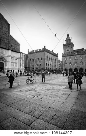 Bologna Italy - January 04 2017: Tightrope walking on a rope over to Piazza Maggiore the center of the medieval city of Bologna in Italy