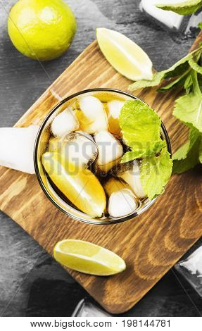 Cocktail Cuba Libre In A Glass On A Dark Background. Top View. Food Background