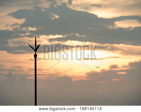 The lightning rod on the roof-tile taken with sunset