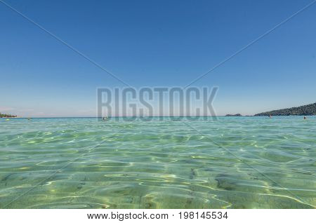 crystal clear sea water view  and horizon with clear blue sky