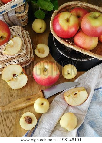 Apples and white nectarines on a wooden table. Fresh autumn harvest