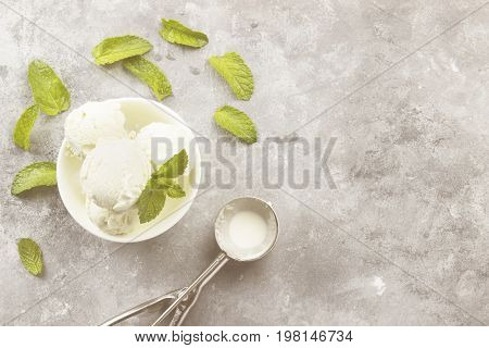 Mint Ice Cream In Bowl On A Gray Background. Top View, Copy Space. Food Background. Toning