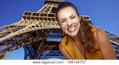 Portrait Of Smiling Young Woman In Paris, France