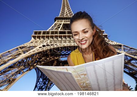Happy Woman Exploring Attractions In Front Of Eiffel Tower
