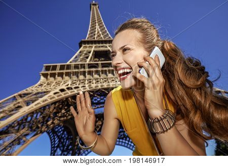 Smiling Woman Speaking On A Cell Phone And Hand Waving In Paris