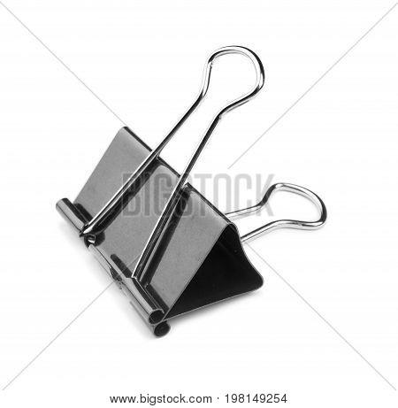 Close-up picture of a single black and metallic binder clip, isolated on a white background. The clerical pin for papers. The office clip for paper stickers.