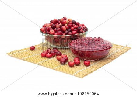 Cranberries and cranberry jam on a white background. Horizontal photo.