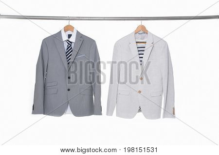 blue and white men's suits ,shirt on hanger
