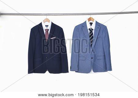 blue and light blue men's suits ,shirt on hanger