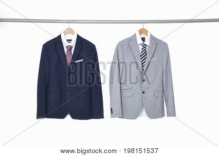 two men's suits ,shirt on hanger –white background
