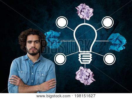 Digital composite of Man standing next to light bulb with crumpled paper balls