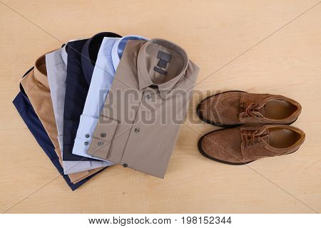Set of man shirt ,shoes on wooden background
