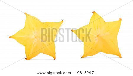 Two cut carambola fruit, isolated on a white background. Star shaped pieces full of vitamins. Decorative carambola for cocktails. A golden-yellow juicy fruit with a star-shaped cross section.