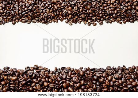 Isolated brown coffee beans on white backround