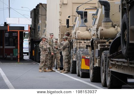 BULGARIA-ROMANIA BORDER - JULY 28 2017: US army convoy personnel and military trucks at the border check point