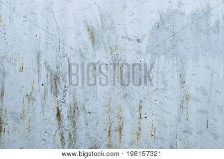 Peeling paint and rusty old metal background. Flaking paint and corrosion on grey metall. Grunge texture