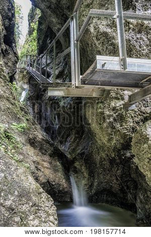 Empty footbridge and water stream in Janosikove diery - tourist attraction in nation park Mala Fatra Slovakia