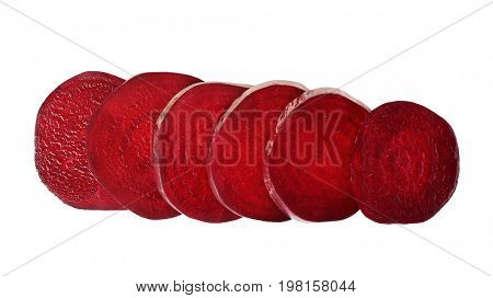 Slices of beet on white background