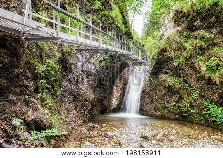 Empty footbridge and cascade in Janosikove diery - tourist attraction in nation park Mala Fatra Slovakia