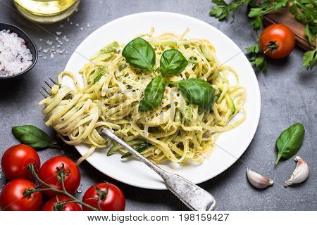 Pasta spaghetti with zucchini basil cream and cheese. Vegetarian vegetable pasta. Zucchini noodles.