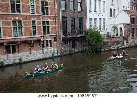 Ghent Belgium - June 26 2011: Tourists rowing canoe tour on Ghent canal