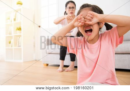 Girl Sitting On The Wooden Floor Crying