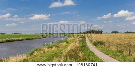 Bicycle path along the Reitdiep river in Groningen Netherlands