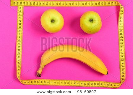 Apples And Banana Framed With Yellow Measuring Tape, Sad Face