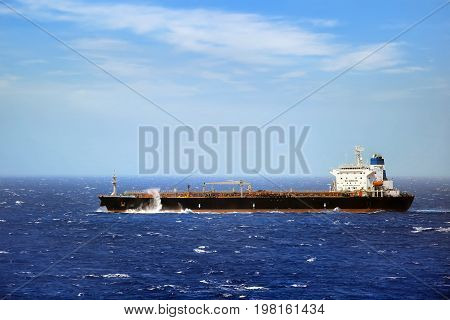 Ship in the sea on stormy day .