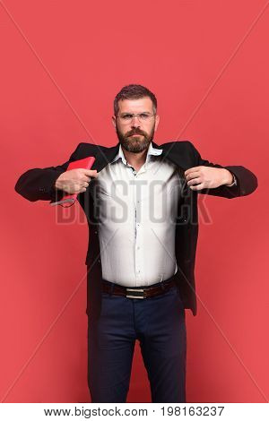 Businessman With Strict Face And Glasses On Light Red Background