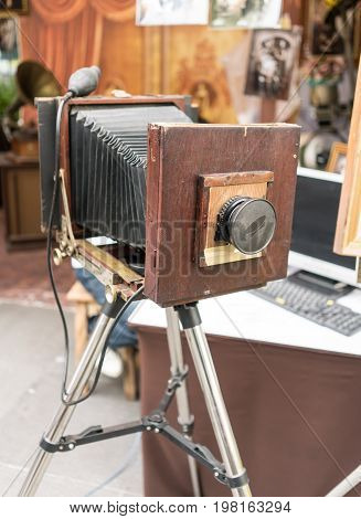 An old retro vintage film camera on a tripod. Large format camera
