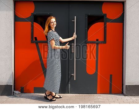 Girl At The Door To The Toilet 02