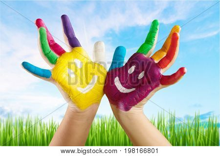 Child hands painted showing elementary age cute girl colours